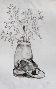 Vase with plants and shoes BW